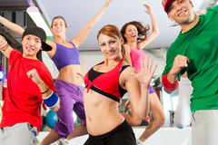 Fitness - Zumba dance workout in gym Stock Images