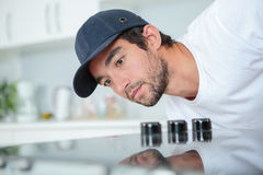 Fitter checking installation hob. Fitter checking installation of hob Royalty Free Stock Images