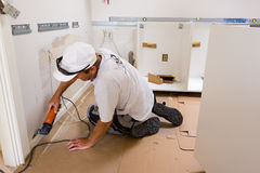 Fitter  mounting new IKEA kitchen. Carpenter at work in Denmark Stock Images