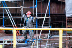 Fitter Shipbuilding. Descent from the scaffold fitter shipbuilding Stock Photography