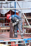 Fitter Shipbuilding. Shipbuilding fitter enduring piece of the hull of the ship spent the exchange Royalty Free Stock Image