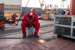 Fitter shipbuilding. During the firing hole in the board tanker Royalty Free Stock Photo