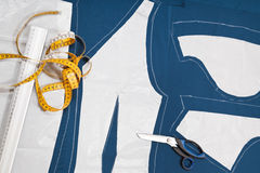 Fitter tools and paper model of clothes Stock Photos
