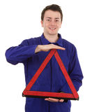 Fitter with triangle. A fitter with a safety warning triangle Royalty Free Stock Images