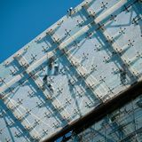 Fitters on a glass roof on a construction site. In Berlin stock images