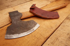 Fitting ax with cutting edge protection. Carpenter Tools on rustic wood Royalty Free Stock Images