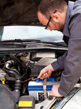 Fitting a battery to a car Royalty Free Stock Photos