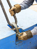 Fitting bolt anchor shackle with wire rope sling. Close up worker fitting bolt anchor shackle with wire rope sling on crane counter weight Stock Photography
