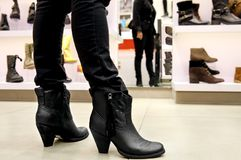 Fitting boots Stock Images