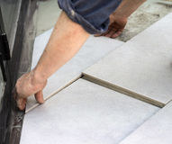 Fitting a floor tile 2 Stock Image