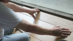 Fitting laminate flooring next to window stock footage