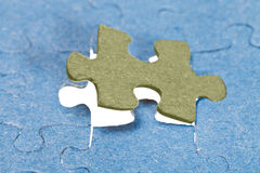 Fitting the last piece of puzzle Royalty Free Stock Images