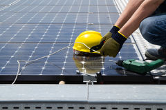 Fitting photovoltaic panel royalty free stock images