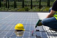 Fitting photovoltaic panel stock photos