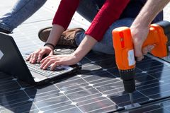 Fitting photovoltaic panels stock photos