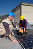 Fitting photovoltaic panels stock image