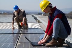 Fitting photovoltaic panels Stock Images