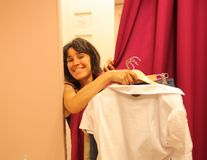Fitting room. Girl trying clothes in a fitting room Royalty Free Stock Photo