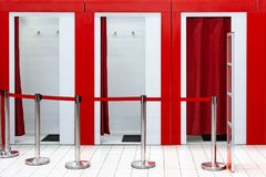 Free Fitting Rooms In The Supermarket. A Clothing Store With A Place For Fitting In The Mall. Anti-theft Gates. Red Ribbon Guard. Stock Photography - 116967382
