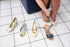 Fitting shoes Stock Photos