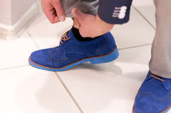 Fitting shoes in the store Royalty Free Stock Photos