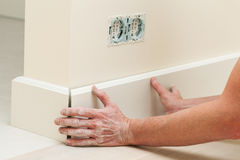 Fitting The Baseboard Royalty Free Stock Images