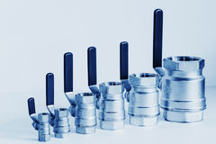 Fittings and ball valve with selective focus on thread fittings. Stock Photography