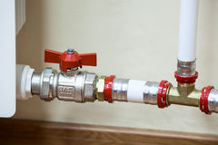 Fittings and PVC pipelines of central heating Royalty Free Stock Images