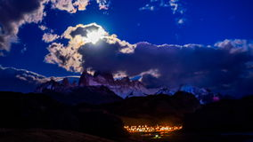 Fitz Roy, the moon and El Chalten village stock video footage