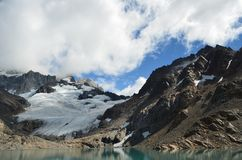 Fitz Roy Mountain covered by clouds. By the lake in a cloudy day Stock Photo