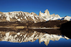 Fitz Roy at Sunrise. Horizontal landscape of Fitz Roy reflected in Laguna Capri at Sunrise with the mountains reflected in the perfectly smooth water stock photos