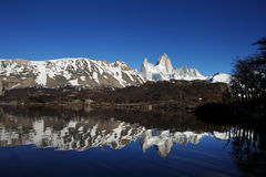 Fitz Roy at Sunrise. Horizontal landscape of Fitz Roy reflected in Laguna Capri at Sunrise with the mountains reflected in the perfectly smooth water royalty free stock photos