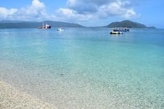Fitzroy island - Cairns. This photo shows a beautiful scenery at the fitzroy island in Cairns. The sea is blue and transparent. There are two small boats and a stock photography