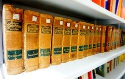 Fiume, Croatia, February 14, 2018. Bookshelf with vintage beautiful old book lexicon stock photography