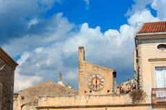 Fiumefreddo Bruzio clock, Calabria, Italy. Fiumefreddo Bruzio clock one of Italy Most Beautiful Villages on mountain hill top above Tyrrhenian sea coast stock images