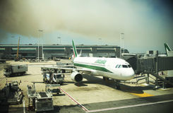 Fiumicino airport disrupts flights and deleyed, fire and smoke on background Royalty Free Stock Images
