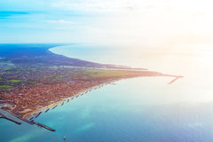 Fiumicino bay from the aircraft. Aerial view of Fiumicino bay, Italy with Mediterranean sea Royalty Free Stock Images