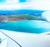 Fiumicino bay from the aircraft. Aerrial view of Fiumicino bay, Italy with Mediterranean sea Royalty Free Stock Image