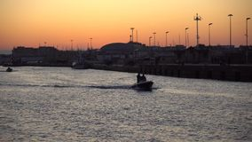 Fiumicino, Italy - 27.10.2019: Little boat for fishing in Fiumicino port in the morning. Fiumicino is famous for the presence of the Leonardo da Vinci– stock video
