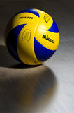 FIVB official volleyball. Closeup of a new model of FIVB (Federation International of Volley Ball) ball manufactured by Mikasa, lying on hardwood floor. This Royalty Free Stock Photo