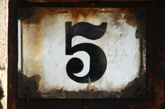 Five. A vintage number five plate Stock Images