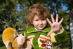 Five. The little girl has extended a hand. Holds in a hand a soft toy Stock Images