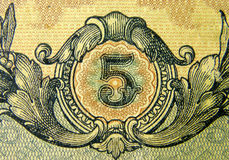 Five. Fragment old banknote par value of five Stock Photo