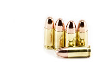 Five 9mm bullets. Isolated on a white background Royalty Free Stock Photo