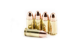 Five 9mm bullets on white. Five 9mm bullets isolated on white Royalty Free Stock Photography