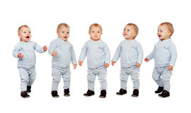 Five adorable babies learning to walk Stock Images