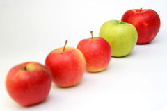 Five apples. Group of four red and one green apples Stock Image