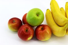 Five apples and four bananas placed on a white background royalty free stock photos