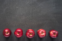 Five apples on painted board Royalty Free Stock Image