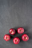 Five apples on painted board Royalty Free Stock Photography
